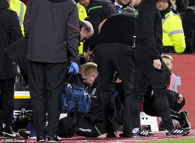 Neil Lennon was hit by a coin on Wednesday night's Hibs' draw with Hearts rival Hearts