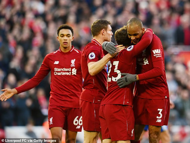 Liverpool celebrate Xherdan Shaqiri's goal against Cardiff - the Reds are unbeaten