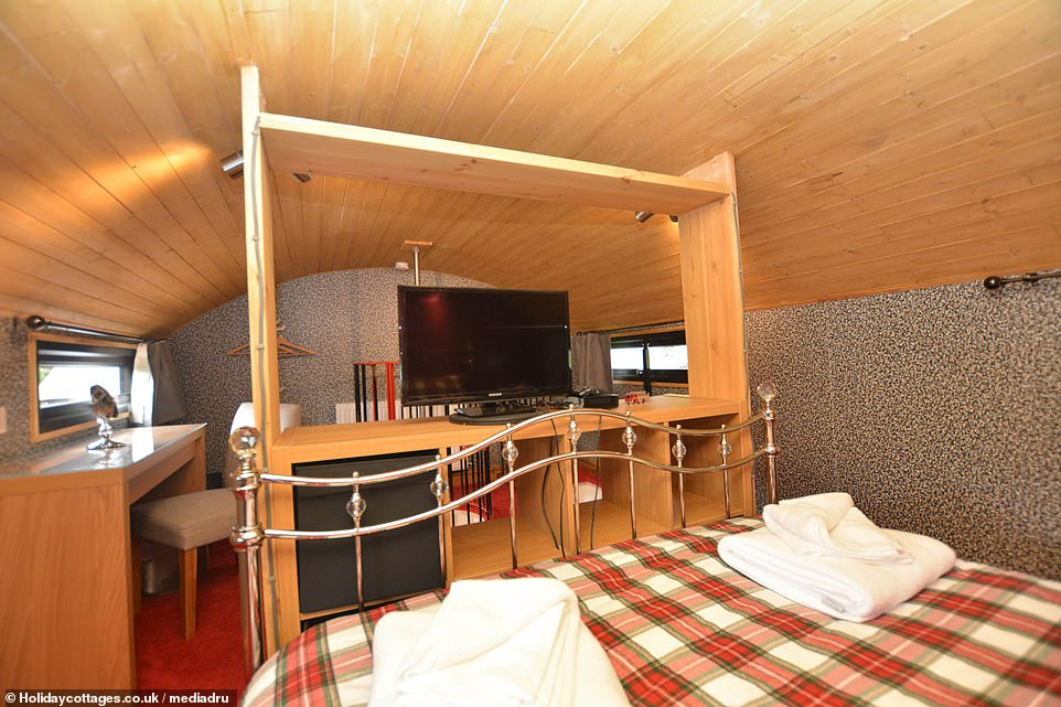 The master bedroom has a large double bed, a Smart TV and a dressing table