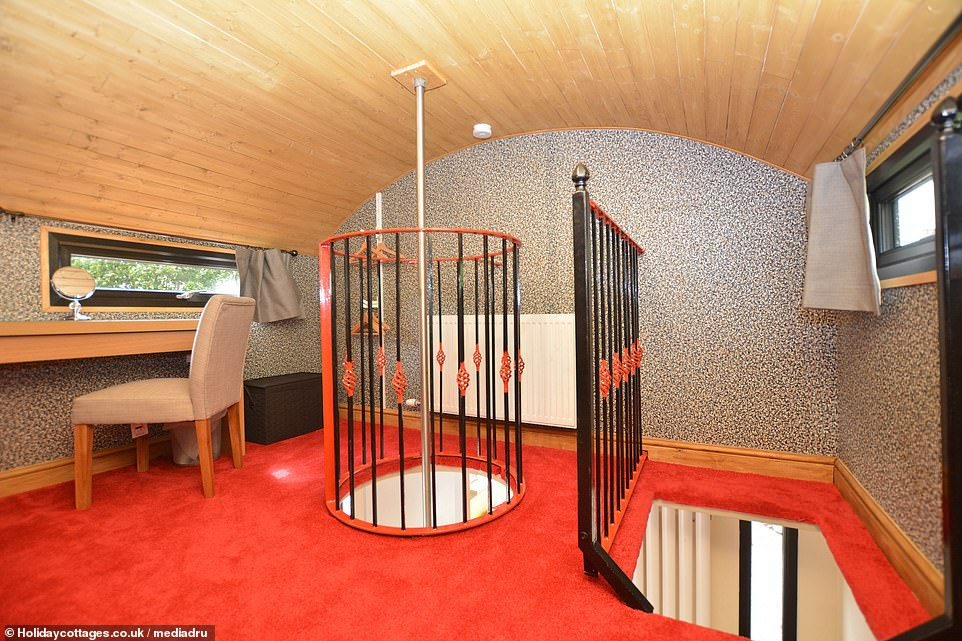 Guests can access the master bedroom by climbing up a ladder on the right, and they can slide down to the left to a fireman's pole