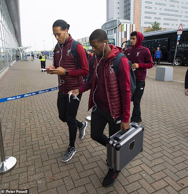 Virgil van Dijk and Georginio Wijnaldum arrive at the airport before traveling to Serbia