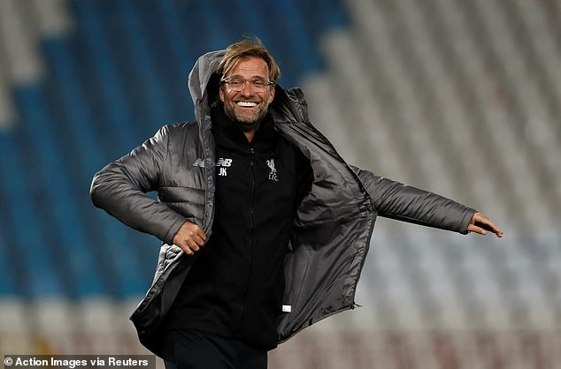 Boss Jürgen Klopp smiled as he put on his jacket during Monday night's workout