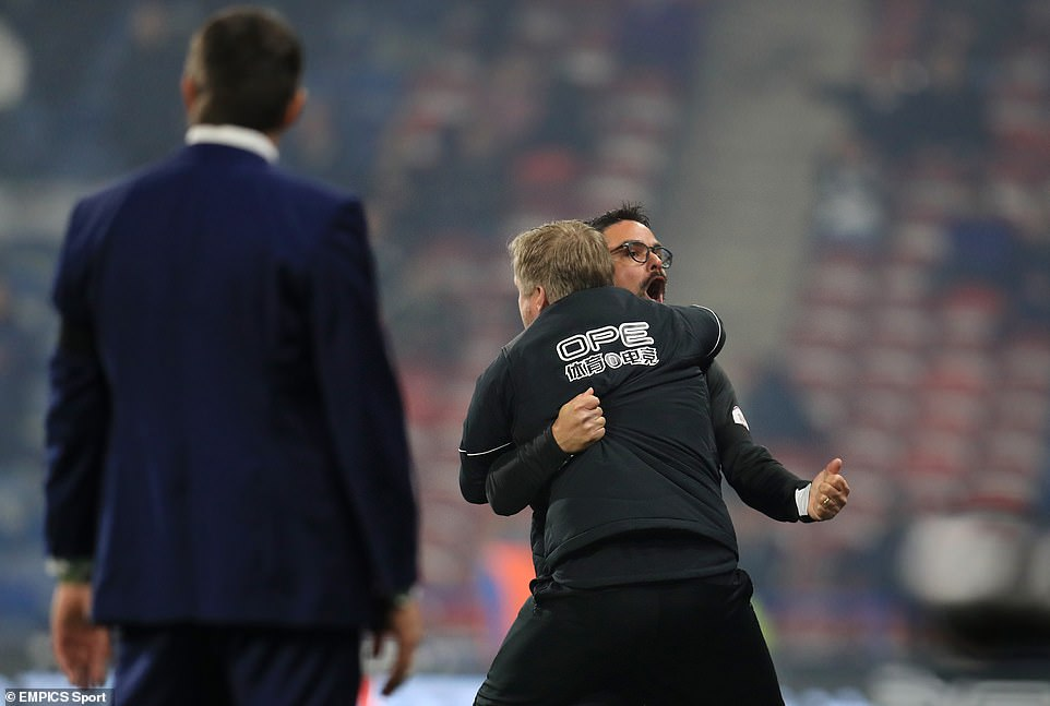 Huddersfield manager David Wagner celebrates the Fosu-Mensah goal on the sidelines while Slavisa watches Jokanovic