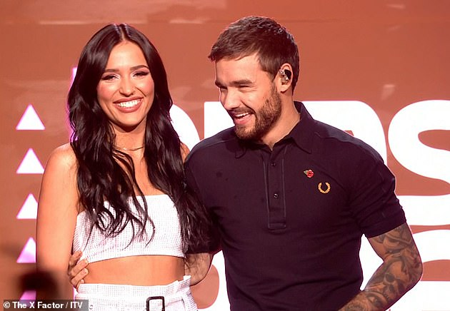 Seeing double:Liam put on a cosy display with Cheryl-lookalike singer Lennon Stella during a duet for Polaroid... which he was 'originally meant to perform with ex-girlfriend'