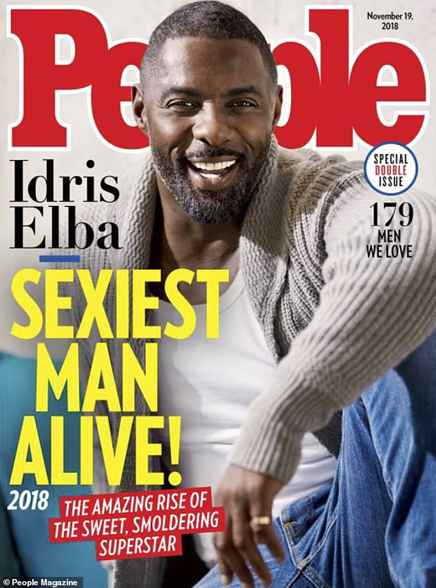 Handsome: The 46-year-old actor kept his look cool in a gray cardigan jumper over a plain white T-shirt and blue jeans for the cover of the eagerly awaited edition