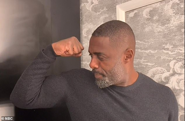 "Funny flex, but ok: Idris showed his big biceps when he was announced when he declared he was the ""sexiest man in the world""."
