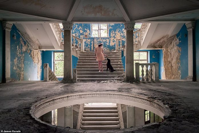 Jade caresses a stray dog in an empty former sanatorium in Georgia. The animal had approached her during the shoot
