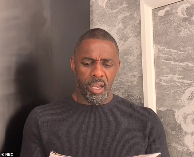 What a moment! Idris looks excited to look at the front of the weekly newspaper for the first time