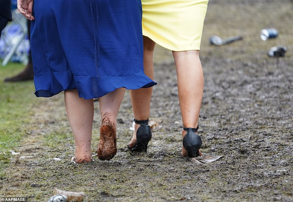 One brave woman walked barefoot through the mud as her friends heels sank in the soaked grounds