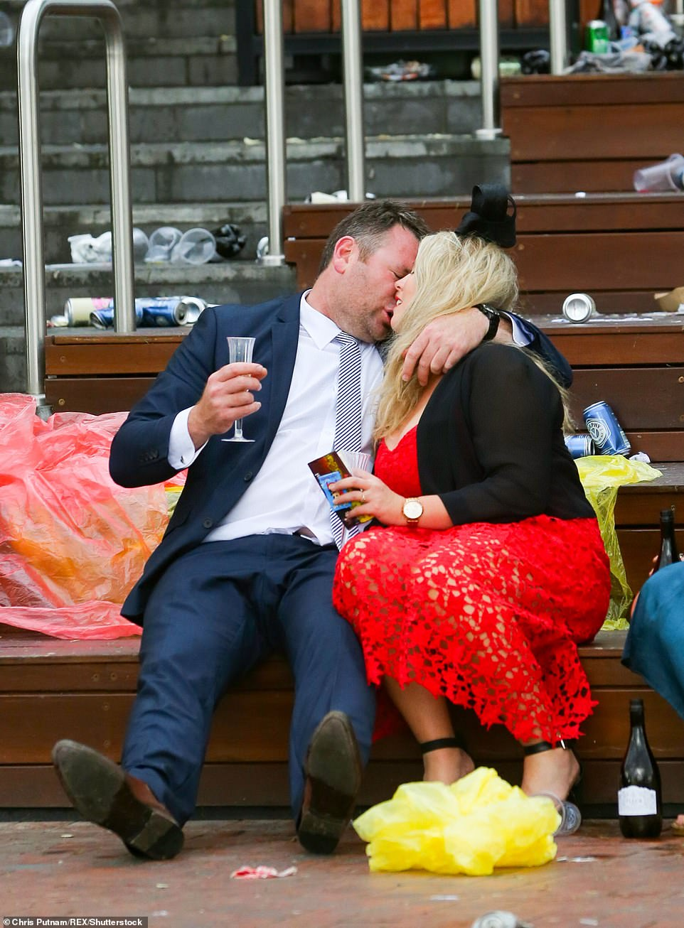 A couple cosy up after the race following a day filled with champagne and festivities in Melbourne