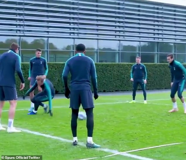 Kane loses his balance as his Tottenham team-mates poke fun at the striker after the nutmeg