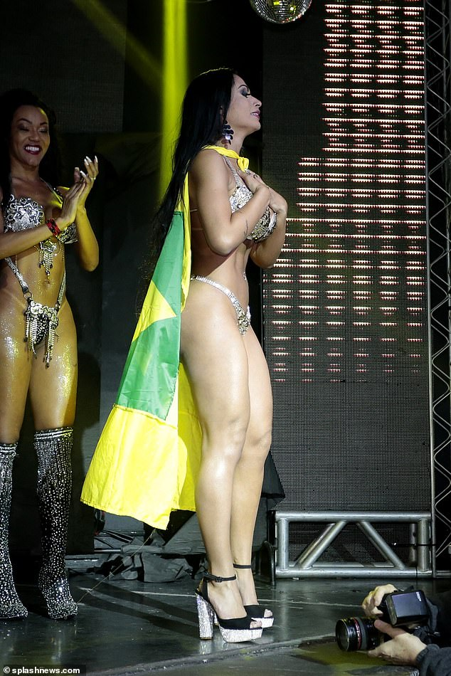 Ms Santana appears to be emotional as she accepts her victory with a Brazilian flag tied around her neck