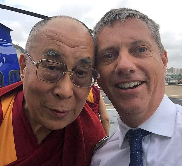 Eric Swaffer pictured withthe Dalai Lama. Mr Swaffer had more than 20 years' experience as a pilot