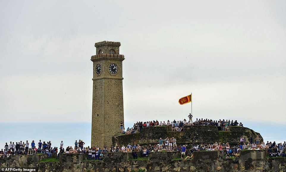 Hundreds of cricket fans lined the ramparts of the 16th-century fortress for a good view of the action on the first day in Galle