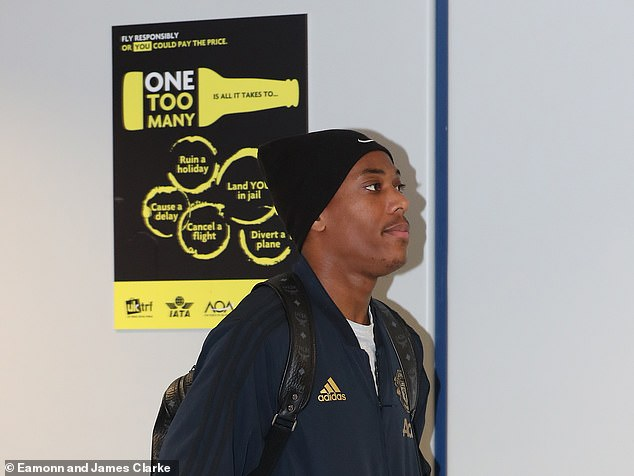Martial walks through the airport terminal ahead of the United flight on Tuesday afternoon