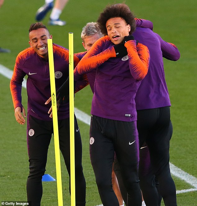 Leroy Sane seems uncomfortable as he jokes with his teammates from the City