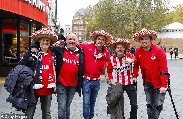 PSV fans are on their feet in the bustling London tourist district