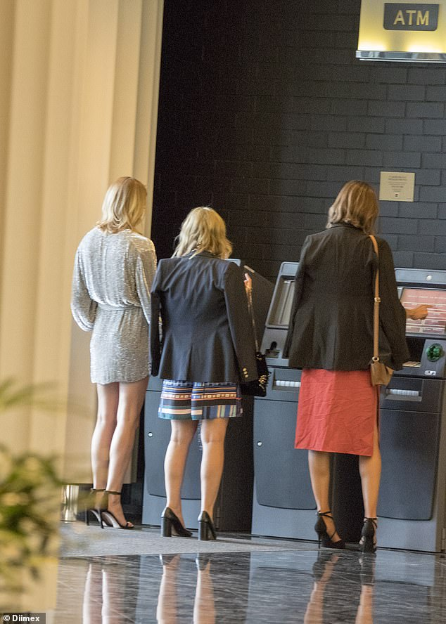 Cashing up: Three of the hen's party, including Jasmine, grabbed some money at a ATM before carrying on with their festivities