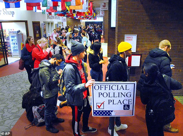 Illinois State University students wait in line to register to vote Tuesday, Nov. 6, 2018, at Bone Student Center in Normal, Illinois