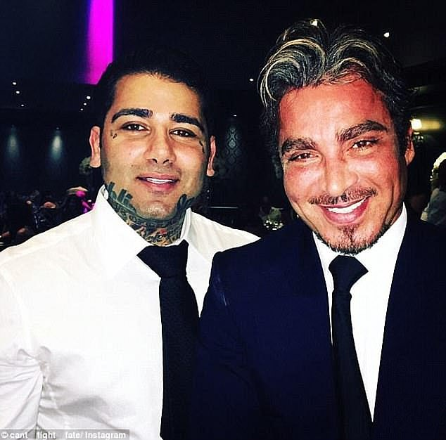Tajjour (left) smiles for a photo with his cousin and Sydney nightclub indenity John Ibrahim (right)