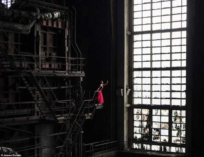 To capture this breathtaking image, Jade climbed the steps of an abandoned former power plant in Hungary, wearing a red dress to demarcate against the bleak background