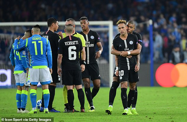 Mbappe leads a frustrated Neymar away from the referee in Stadio San Paolo