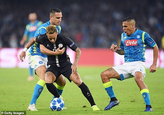 Neymar attempts to get away from Napoli's Nikola Maksimovic during the Group C clash