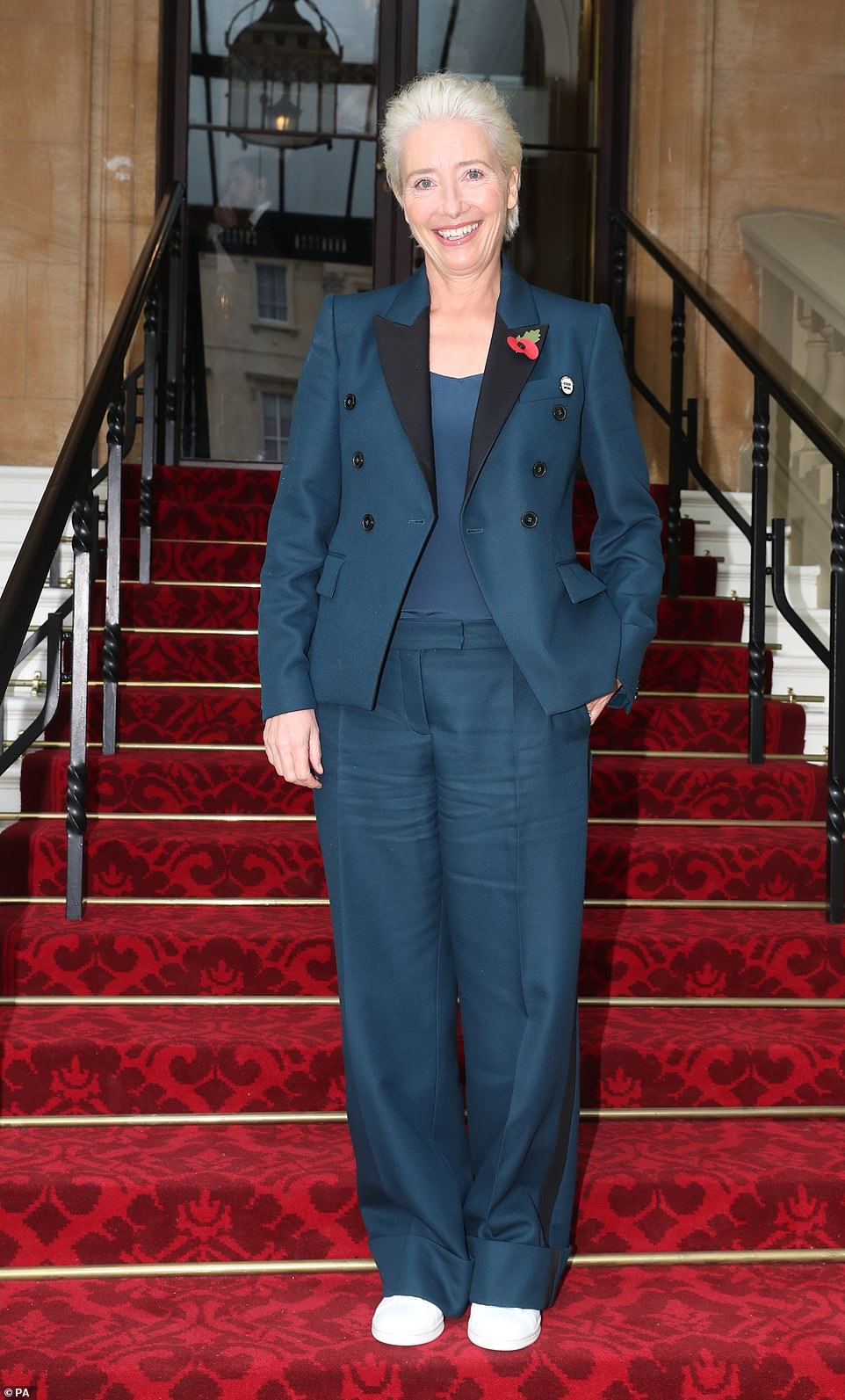 Dressed the part: The Sense and Sensibility actress, 59, looked polished for the ceremony in a turquoise trouser suit characterized by contrasting black lapels and matching pants lining