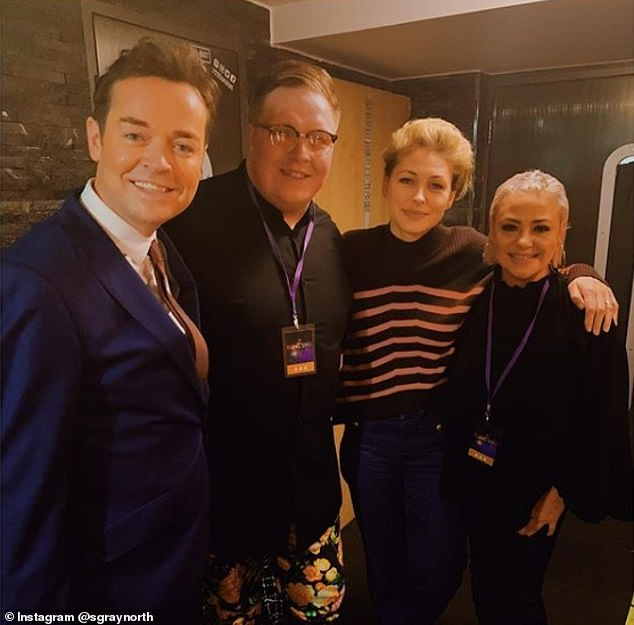 All smiles: On Tuesday, Lisa judged the Rising Star competition at Under the Bridge in London on Tuesday night, alongsideStephen Mulhern, left, and Emma Willis