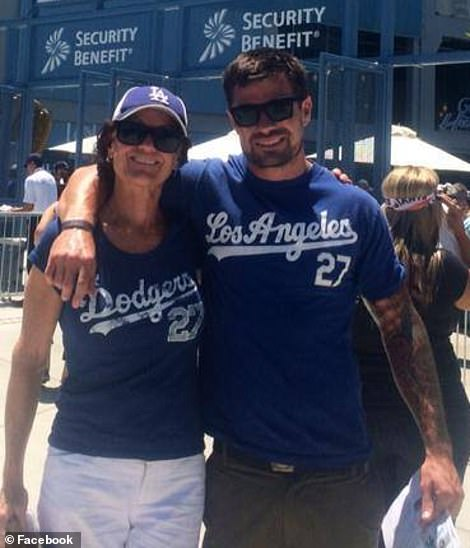 The gunman is pictured in a 2014 picture with his mother. Witnesses told of his extensive tattoos after Wednesday night's attack. Neighbors say he was known to have PTSD