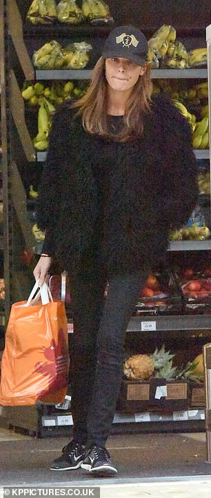 Shopping:The model dressed down as she stocked up on essentials