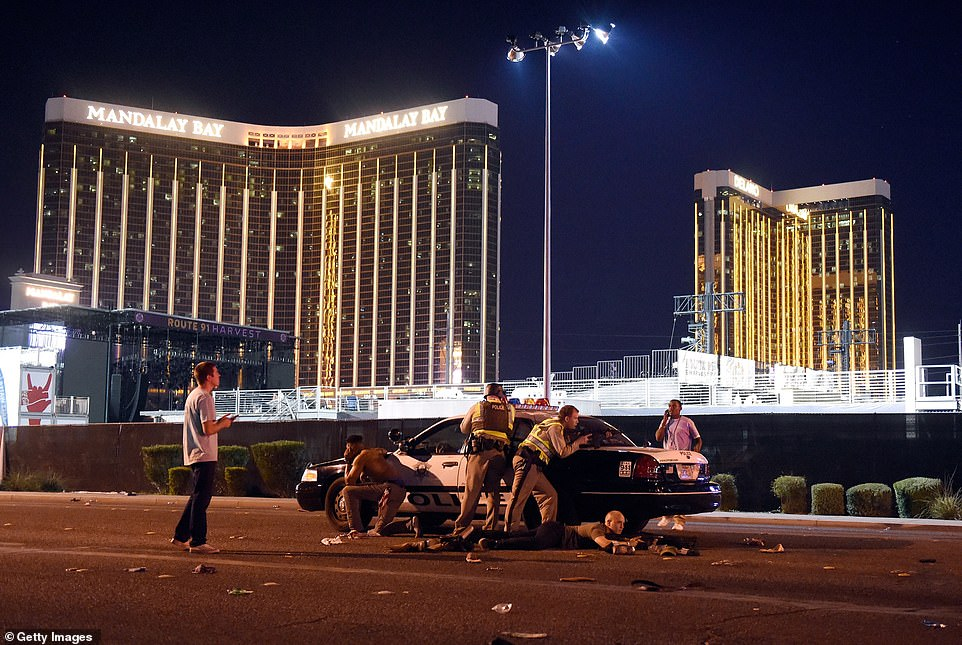 Las Vegas: Police stand guard along the streets outside the festival grounds of the Route 91 Harvest last year after the shooting which saw 58 people killed