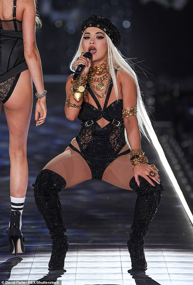 Giving it her all: Rita broke out her best sultry moves as she showed off her gold chains