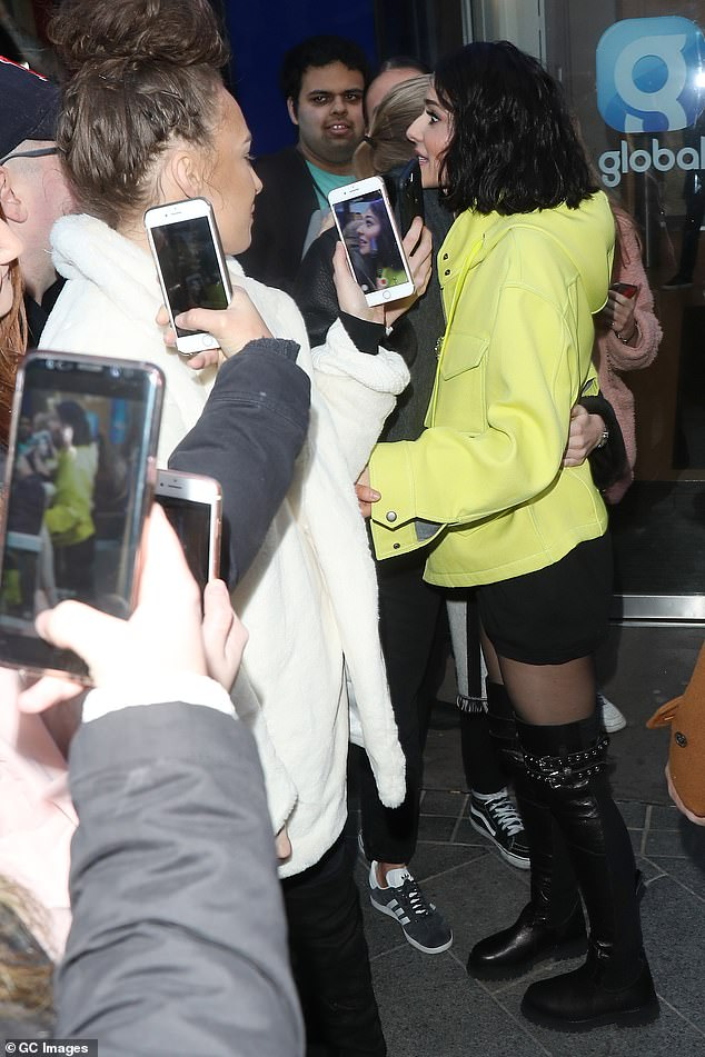 Lucky fans: those who waited in the cold to see Cheryl seemed electrified when she stopped to be photographed with them