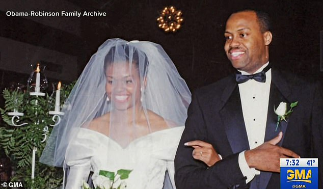 Meant to be: After Barack kissed her for the first time Michelle, pictured being walked down the aisle at their wedding, says she felt a rush of emotion