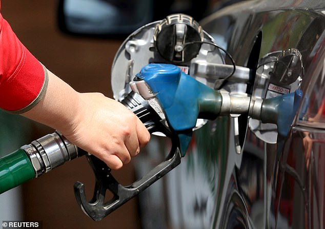 Fuel rip-off: Campaigners said what's on average 5p a liter more expensive than it should be while diesel what 3p steeper than necessary