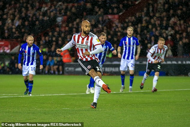 David McGoldrick takes the penalty for Sheffield United but sees his efforts saved in the first half