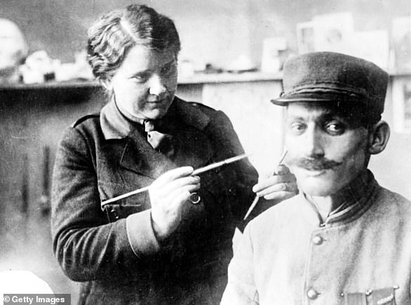 Anna Coleman Ladd, an American celebrity and sculptor who followed her husband to Europe at the beginning of World War I, found her craft in prosthetics. She has changed the lives of more than 200 soldiers. Here she works on a prosthetic mask worn by a French soldier to hide his disfigurement in July 1918