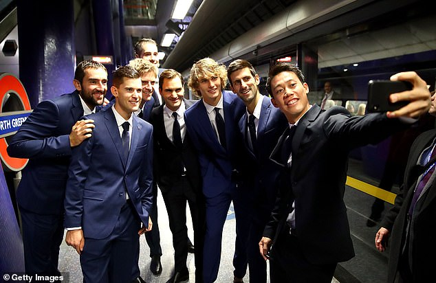 (From left to right) Marin Cilic, Dominic Thiem, Kevin Anderson, John Isner, Federer, Alexander Zverev, Djokovic and Kei Nishikori posed for a photo on the North Greenwich platform
