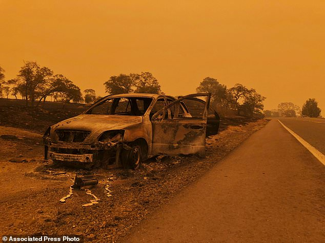 A burned out car sits on the side of the road in Paradise, Calif., Friday, Nov. 9, 2018, after a wildfire swept through the area. (AP Photo / Gillian Flaccus)