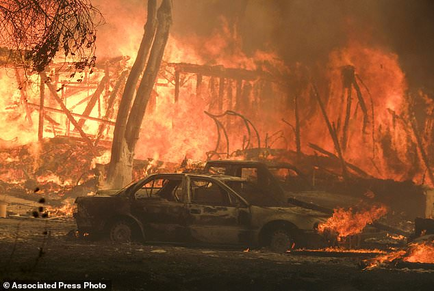 A wildfire burns a structure near Malibu Lake in Malibu, Calif., Friday, Nov. 9, 2018. About two-thirds of the city of Malibu was ordered early Friday as a ferocious wildfire near the beachside community that is home to about 13,000 residents, some of them Hollywood celebrities. (AP Photo / Ringo H.W. Chiu)