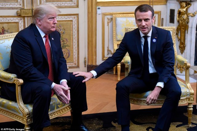 Donald Trump looks on at French president Emmanuel Macron prior to their meeting at the Elysee Palace