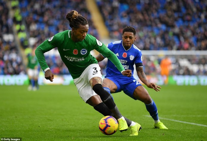 Brighton's defender, Gaetan Bong, quickly changes direction to try to cheat Cardiff's Harris and retain possession