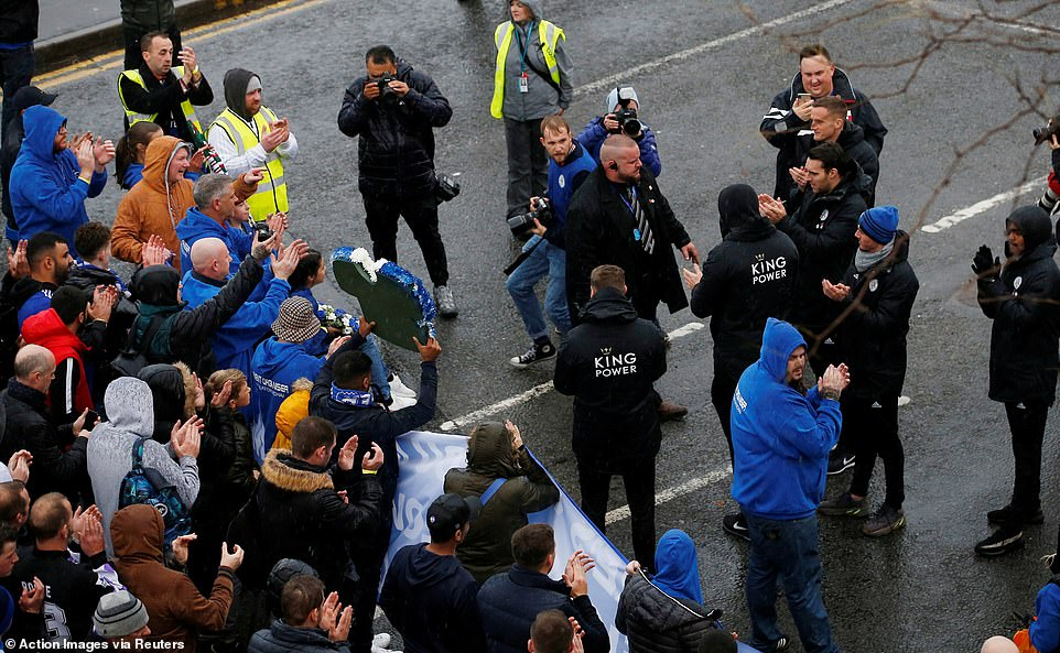 Leicester players welcome the marchers as they go down before the Premier League clash