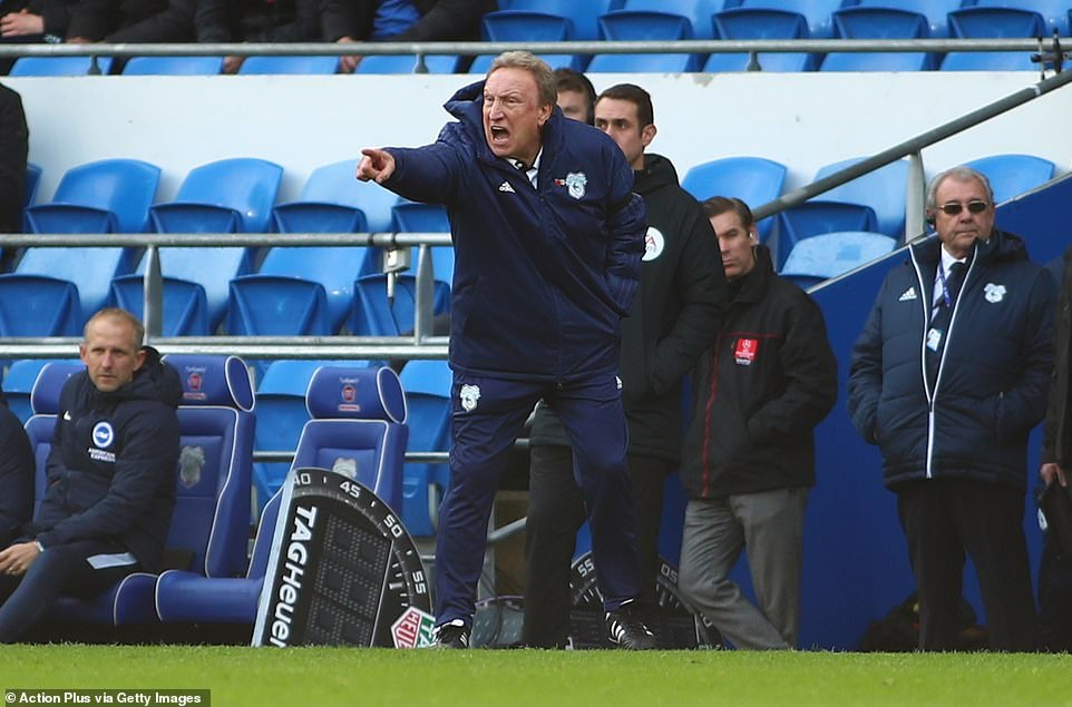 Neil Warnock shouts instructions to his players from the touchline during the first half at Cardiff City Stadium