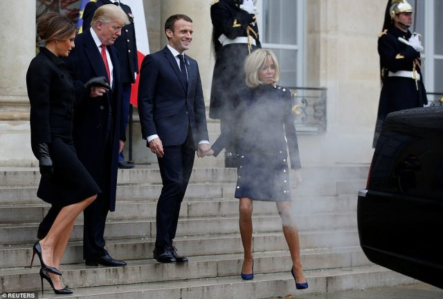 The leaders and first ladies walk down the steps after the meeting.Trump had begun the short trip to Paris for an event commemorating the end of the first major conflict between nations by laying into Macron for his European army proposal but had calmed down by the time they met Saturday for extended talks