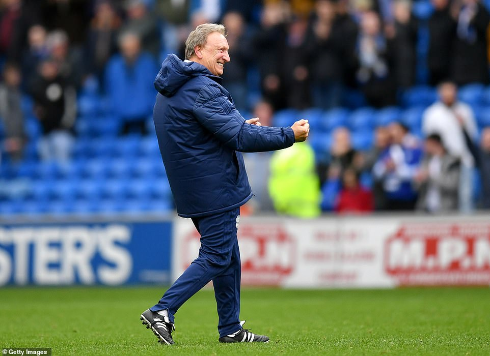 Cardiff manager Neil Warnock celebrated his fists at the final whistle after his team claimed all three points