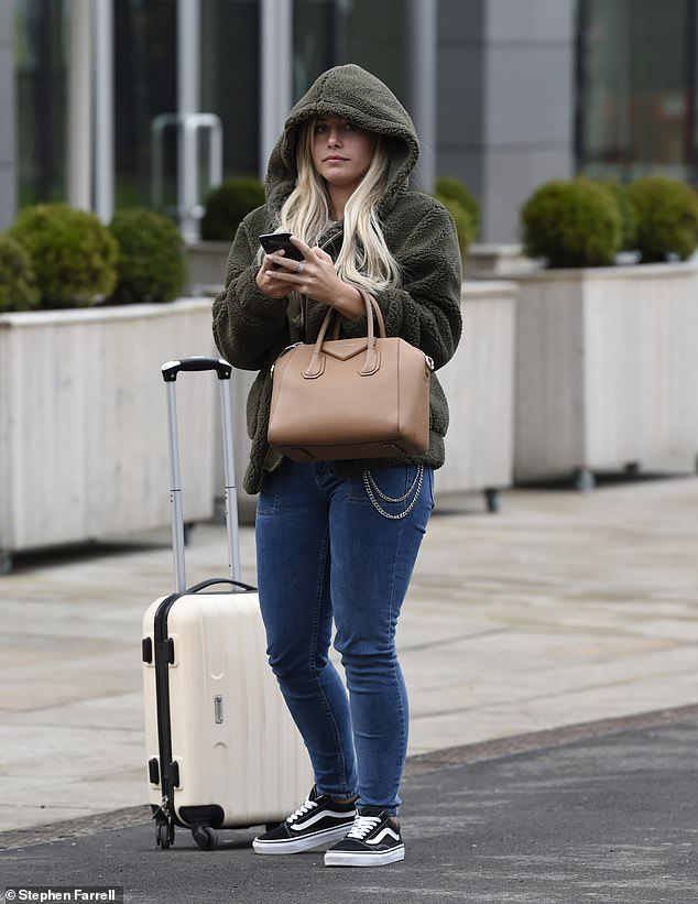 Shy: Going makeup free, the reality star, 20, kept her long blonde locks flowing freely, while she carried a brown handbag and cream suitcase