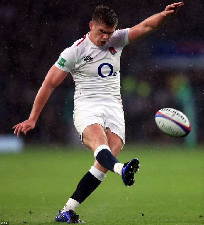 England's Farrell successfully kicked a conversion to put England 15-0 lead in the first half of Saturday's afternoon clash