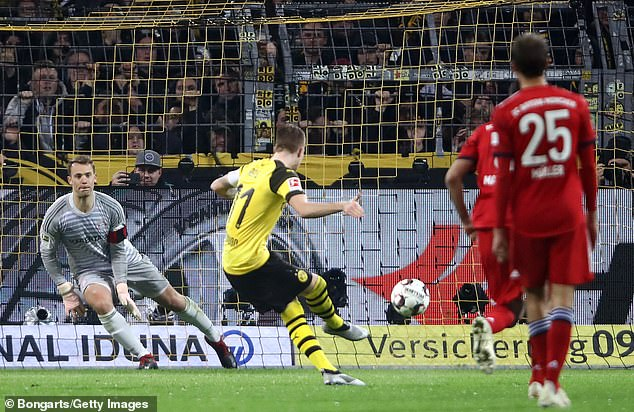 Marco Reus slots home a penalty early in the second half to ensure parity is restored